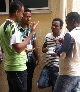 Sisay, Finance/Admin Manager explains project budgeting to Yitbarek, Berhanu, and Kuru